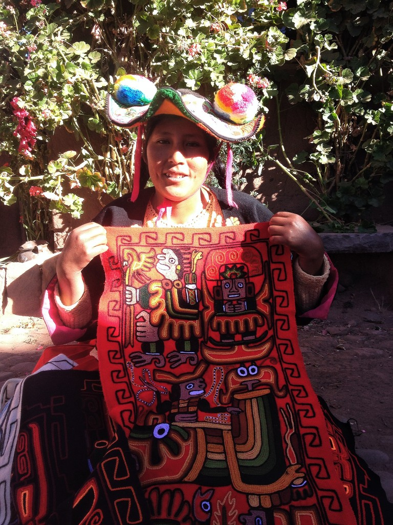 She was our homestay mamacita.  I might have been about 15 years older than here - but her mother in-law's name was Aurora tambien, so she called me 'mi madrina'.  Here she is showing off some of her embroidery work.